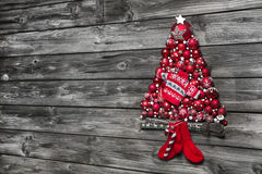 Christmas background of wood decorated with a tree of red balls. stock photo