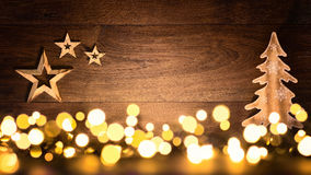 Christmas background with wood and lights royalty free stock images