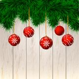 Christmas background. Wooden background. With fir-tree branches and toys Stock Photos