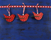 Christmas background with wooden birds on dark blue vintage wood. Royalty Free Stock Images