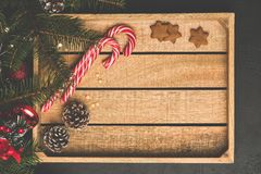 Christmas Background Wooden Box Candy Cane Fir Tree. Top View, Copy Space For Text. Winter Holidays Frame Background stock photography