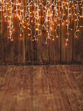 Christmas background, wooden copy space and lights garland Royalty Free Stock Image