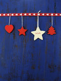 Christmas background with wooden decorations on dark blue vintage wood. Vertical. Stock Photo