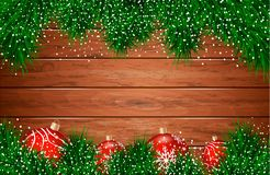 Christmas background. Wooden background. With fir-tree branches and toys Stock Photo