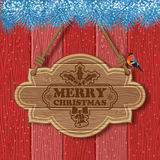 Christmas background. With Wooden Sign, Fir Branches and Bullfinch on Red Wooden Boards background. Vector Template for Cover, Flyer, Brochure, Greeting Card Royalty Free Stock Photos