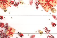 Christmas background with wrapped gift boxes and baubles on white wood. stock images