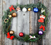 Christmas background with wreath balls and decorations over wood Stock Photo