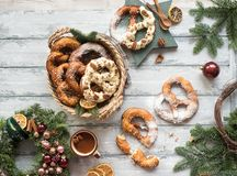 Christmas background with Christmas wreath and pretzel. Over wood Stock Photo