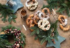Christmas background with Christmas wreath and pretzel. Over wood Stock Photos