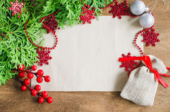 Christmas background with xmas decoration, blank postcard on wooden background. Copy space. Merry christmas. Stock Photos