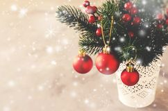 Christmas background with xmas fir branches and decorations. Christmas greeting postcard. Christmas background with xmas fir branches and decorations in the snow stock image