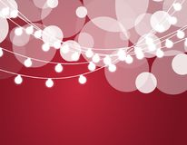 Christmas background with xmas lights. Vector glowing garland  on red background with shine particles. Vector Royalty Free Stock Photo