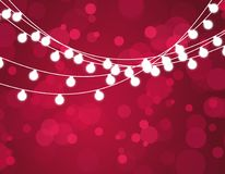 Christmas background with xmas lights. Vector glowing garland  on red background with shine particles. Vector Stock Photo