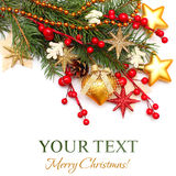 Christmas background - Xmas tree, gold decoration. Red berry on white Royalty Free Stock Images