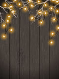 Christmas background, yellow lights on dark wood, illustration. Christmas background, yellow electric lights on dark wooden wall hanging in white dry branches Royalty Free Stock Photo