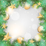 Christmas background with yellow ornaments and branches Royalty Free Stock Images