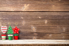Christmas backgrounds. Christmas decor on the wooden background stock photography