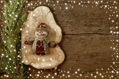 Christmas backgrounds. Christmas background snowman on wooden background copy space Stock Image