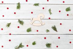 Christmas backgrounds. Berries of viburnum with spruce and woode Stock Image