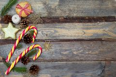 Christmas backgrounds. Christmas toys, Christmas candies on a wooden background royalty free stock image