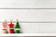 Christmas backgrounds. Christmas decor on the white wooden background royalty free stock images