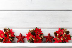 Christmas backgrounds. Christmas decor on the white wooden background stock image