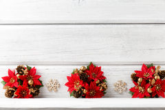 Christmas backgrounds. Christmas decor on the white wooden background Royalty Free Stock Photos