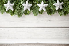 Christmas backgrounds. Christmas decor on the white wooden background Stock Photography