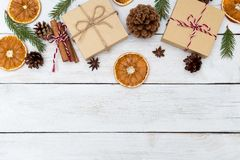 Christmas backgrounds with gift box; cinnamon, orange. Flat lay stock photos