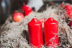 Christmas backgrounds - red candle, apple and pine cone Stock Photo