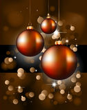Christmas Backgrounds with Stunning Baubles. Suggestive Elegant Christmas Backgrounds with Stunning Baubles and Glitter elements Stock Images