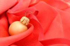 Christmas. Backgrund with gold ball on red silk Stock Photography
