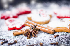 Christmas backround. Cinnamon with star anize on a flour and dark table.Flour and spices for a christmas baking Royalty Free Stock Photos