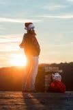 Christmas bad santa on chimney Royalty Free Stock Image