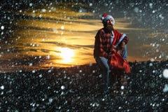 Christmas bad santa on chimney Royalty Free Stock Images