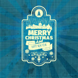 Christmas badge label. Typographic, grange,retro-blue tilt old paper Calligraphic vintage frame with Merry Christmas and Happy Holidays wishes Royalty Free Stock Photography