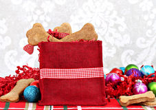Christmas bag filled with homemade bone shaped dog biscuits. stock photography