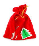 Christmas bag with gifts. Isolated on a white background Stock Photos