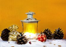 Christmas bag with gifts, Christmas decorations and lantern Stock Photos