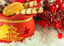 Christmas bag with gifts, cookies and  candy Stock Images