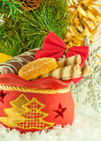Christmas bag with gifts, cookies and fruit candy Stock Images