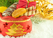 Christmas bag with gifts, cookies and fruit candy, Stock Image