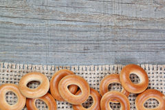 Christmas  bagels on sackcloth texture wood. Stock Images