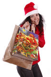 Christmas bags. Woman portraying father Christmas with a cheerful smile Stock Image