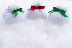Christmas bags with gifts are on the snow stock photo