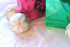 Christmas bags and ornaments on white background royalty free stock photography