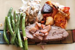 Christmas baked dinner with meat and vegetables Royalty Free Stock Photography