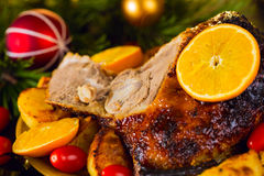 Christmas baked duck served with potatoes, orange and tomatoes Royalty Free Stock Photo