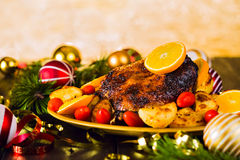 Christmas baked duck served with potatoes, orange and tomatoes Stock Photo