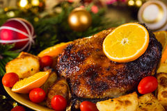 Christmas baked duck served with potatoes, orange and tomatoes Royalty Free Stock Image